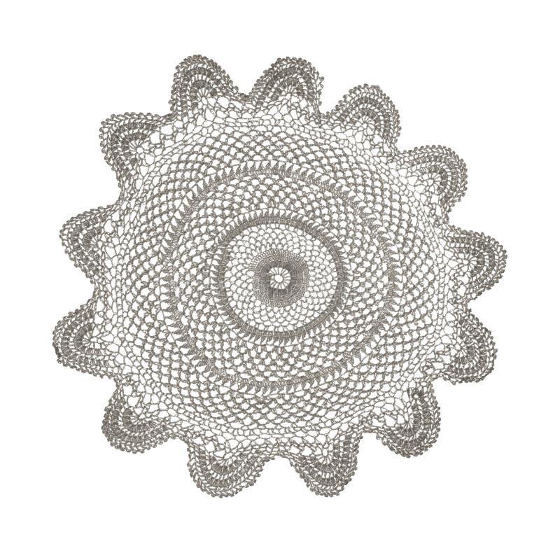 在白色隔绝的钩针编织小垫布 免版税库存图片