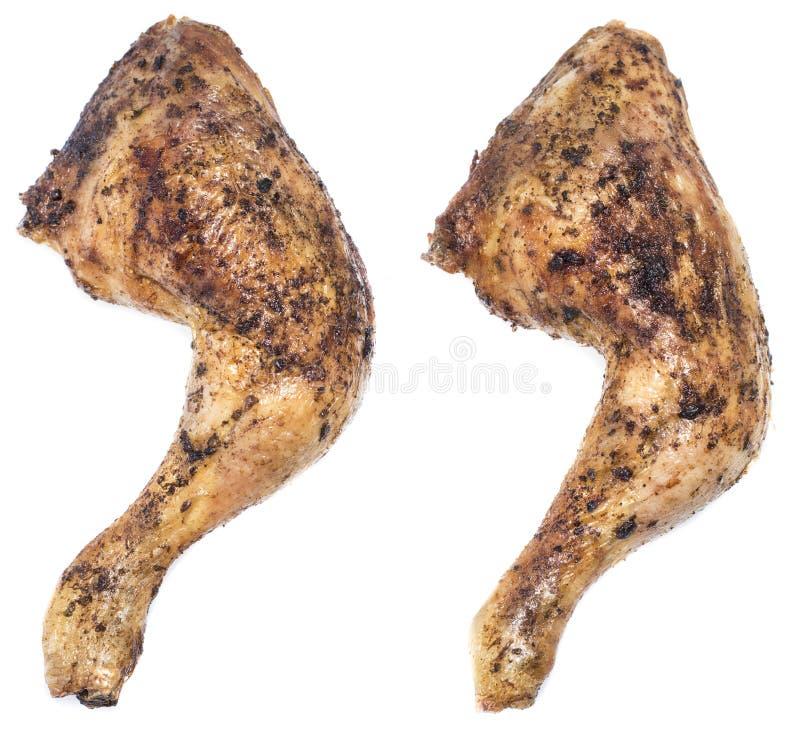 在白色隔绝的鸡腿 免版税库存图片