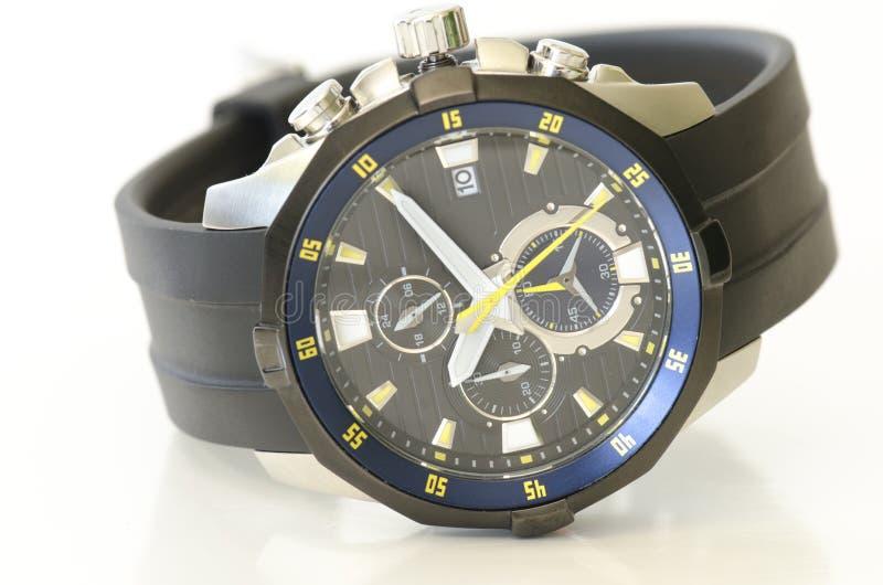 在白色隔绝的黑人和海洋蓝色人的手表 库存照片