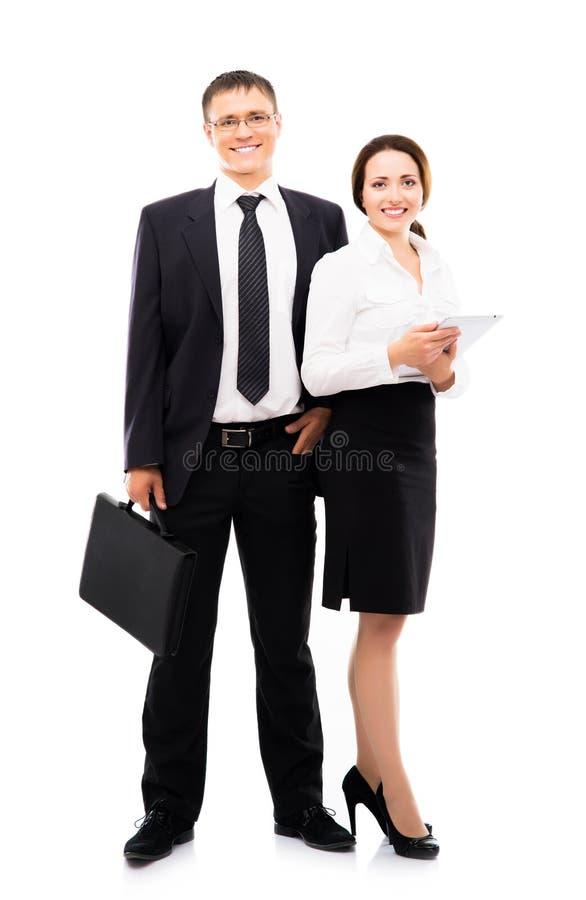 在白色隔绝的年轻和愉快的企业夫妇 图库摄影