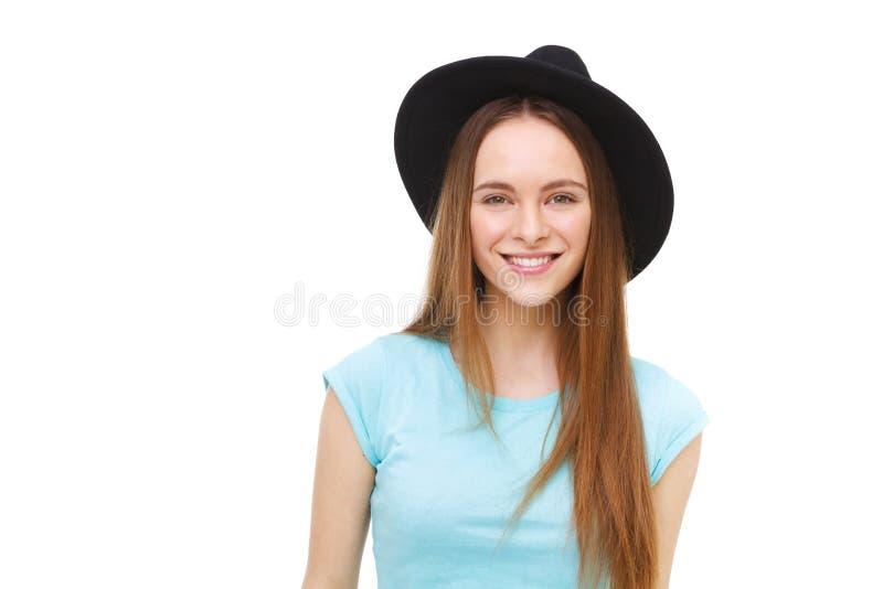 在白色隔绝的黑帽会议画象的美丽的少妇 库存图片