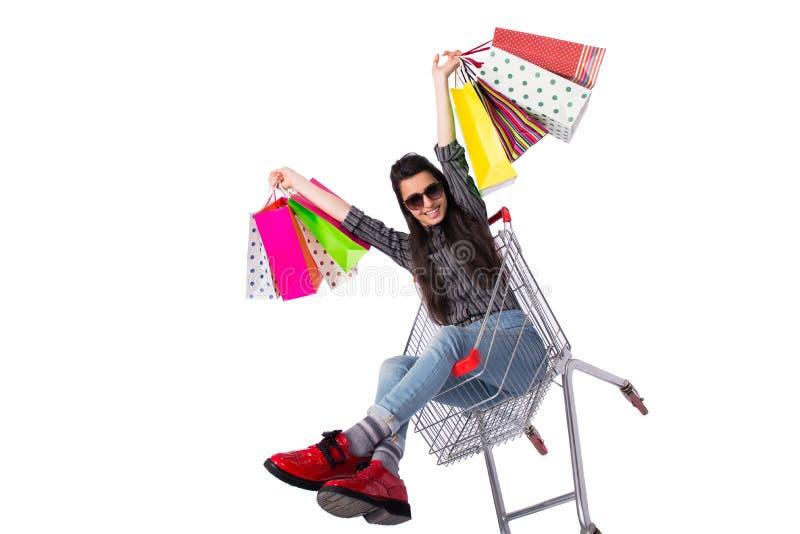 在白色隔绝的购物以后的少妇happer 库存照片