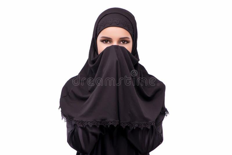 在白色隔绝的黑礼服的回教妇女 库存照片