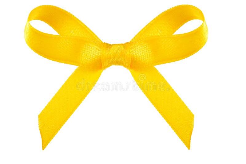 在白色隔绝的黄色缎礼物弓 免版税库存照片