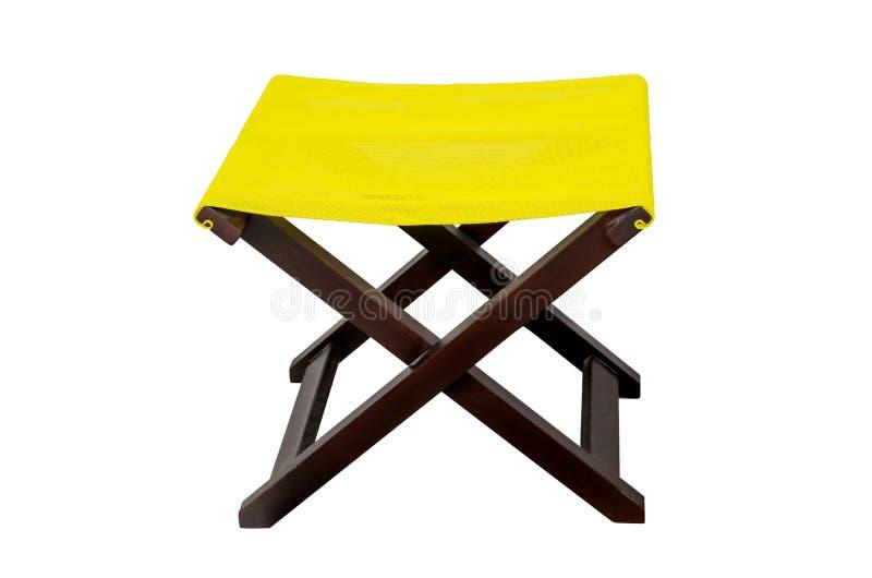 在白色隔绝的黄色deckchair 库存照片