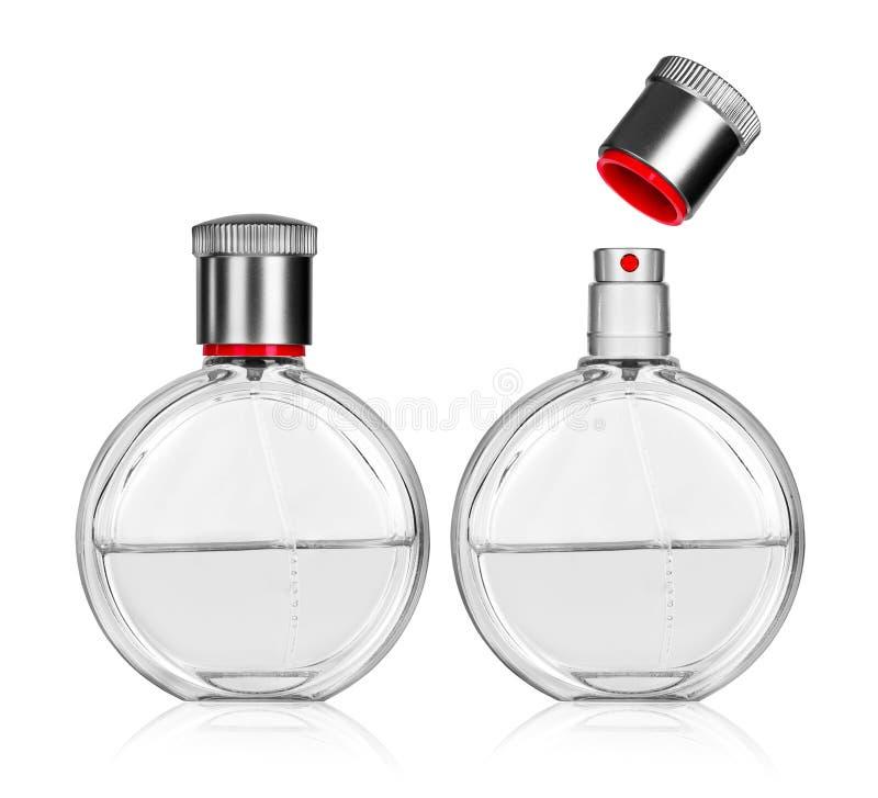 在白色香水隔绝的闭合和开放瓶 免版税库存照片