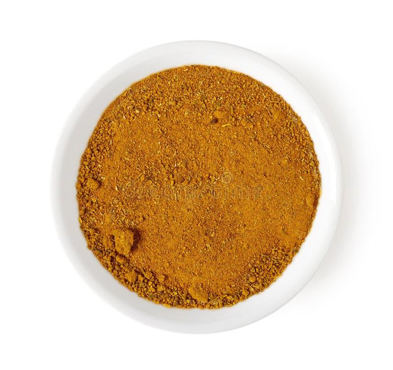 在白色,顶视图咖喱粉隔绝的碗 免版税图库摄影