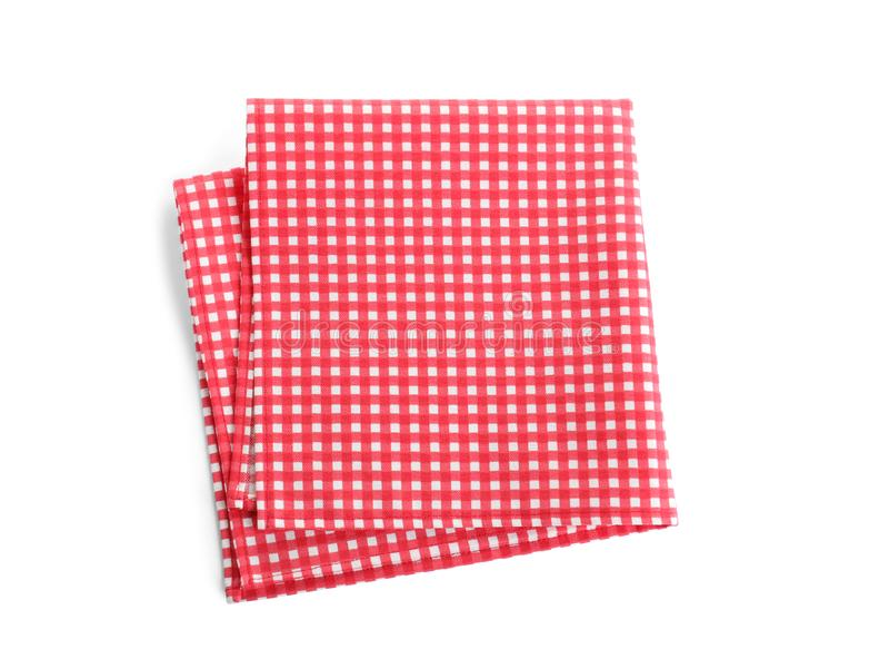 在白色,顶视图的被折叠的红色方格的桌布 库存图片
