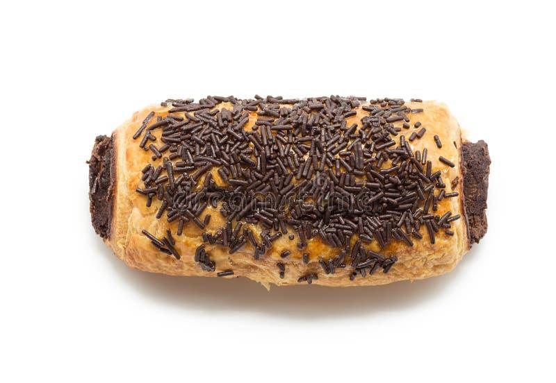 在白色(痛苦澳大利亚chocolat)隔绝的巧克力新月形面包 库存图片