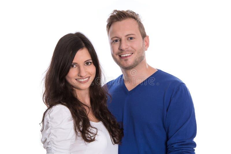 在白色-隔绝的爱的年轻愉快的夫妇。 库存图片