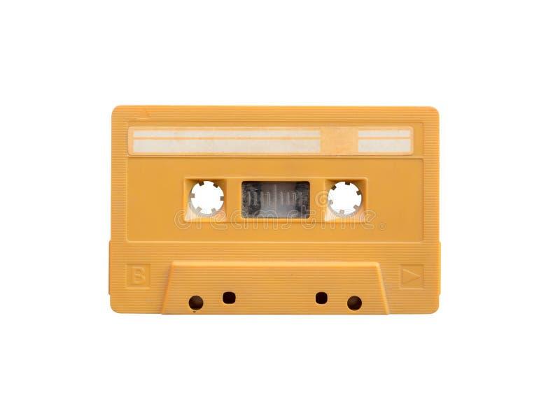 在白色B隔绝的葡萄酒黄色卡型盒式录音机磁带边 库存照片