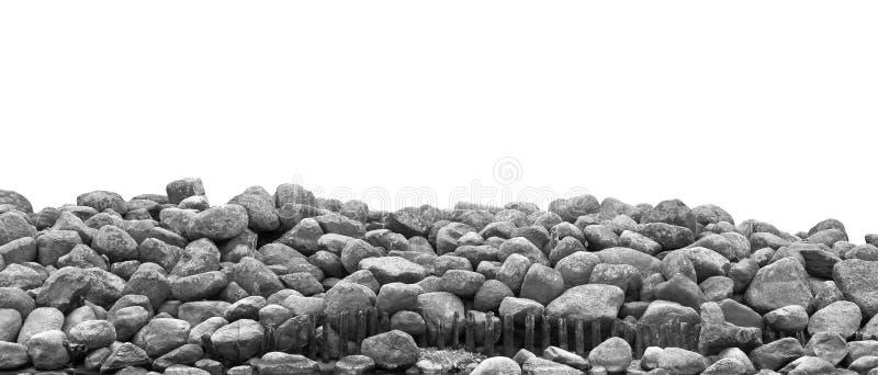 在白色backg隔绝的堆黑白石头和岩石 免版税库存图片