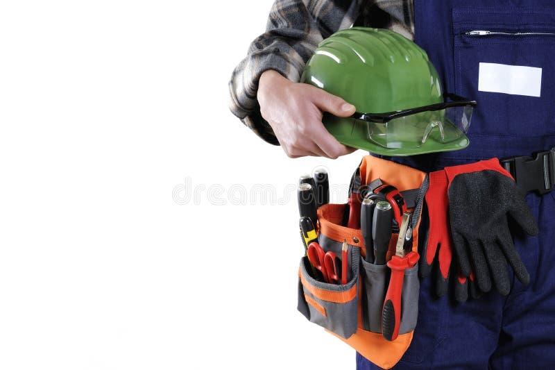 在白色backg隔绝的工作服的年轻电工技术员 免版税库存照片