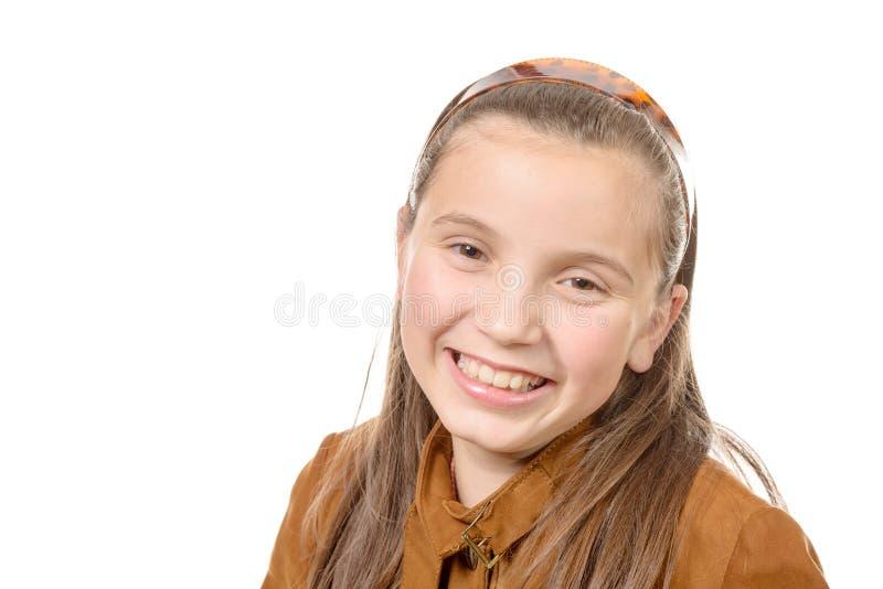 在白色backg隔绝的年轻美丽的十几岁的女孩画象  图库摄影