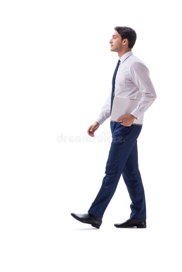 在白色backgro隔绝的商人走的常设侧视图 免版税库存照片