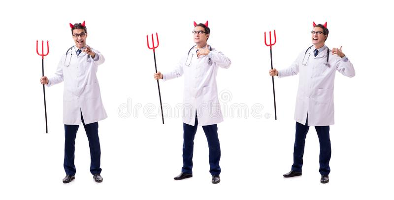 在白色backgrou滑稽的医疗概念的恶魔医生隔绝的 库存照片