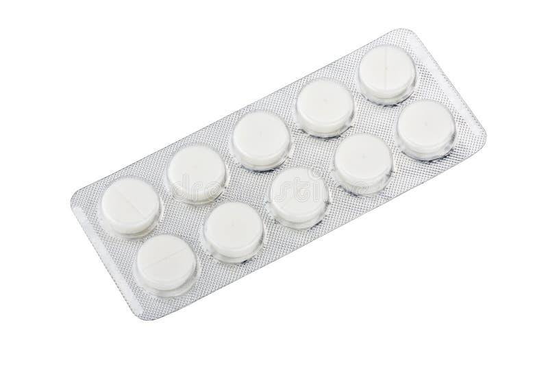 在白色backgrou隔绝的银色天线罩包装的医疗药片 库存图片