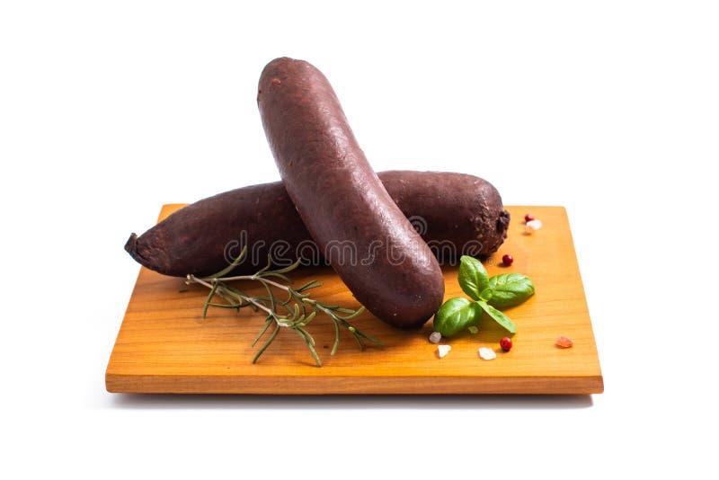 在白色backgroud的食物概念未加工的血布丁黑色香肠 库存照片