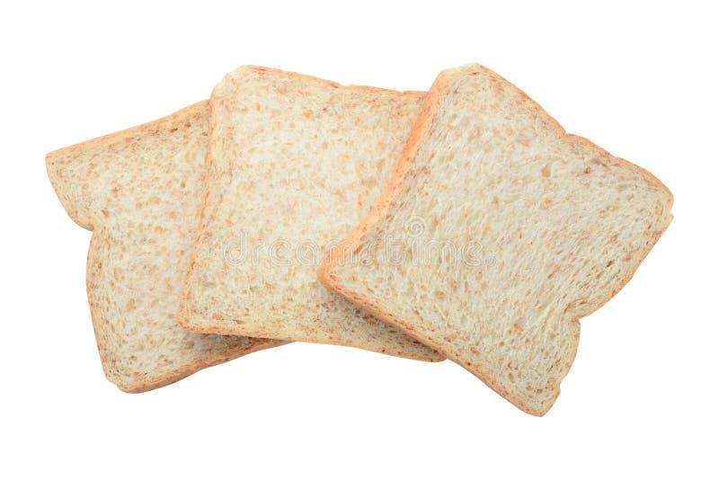 在白色backgroun隔绝的三个新全麦面包切片 库存图片