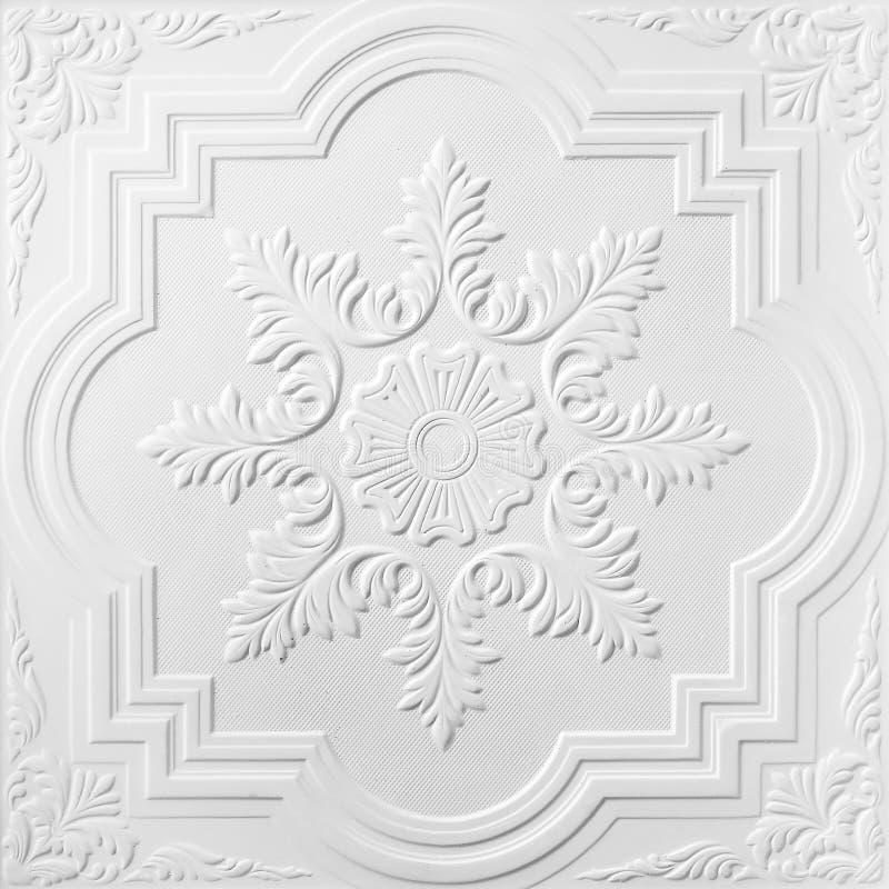 在白花天花板石膏板料的样式  库存图片