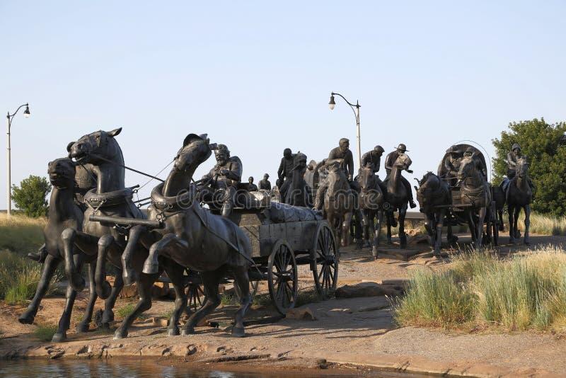 在百年土地奔跑纪念碑的小组雕塑 库存图片
