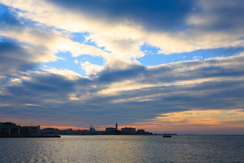 在的里雅斯特,意大利港的日落  图库摄影
