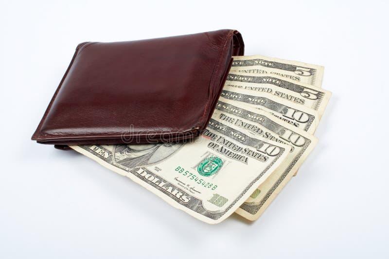 在皮革老钱包里面的票据 免版税库存照片