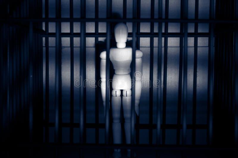 在监狱的木木偶 免版税库存图片