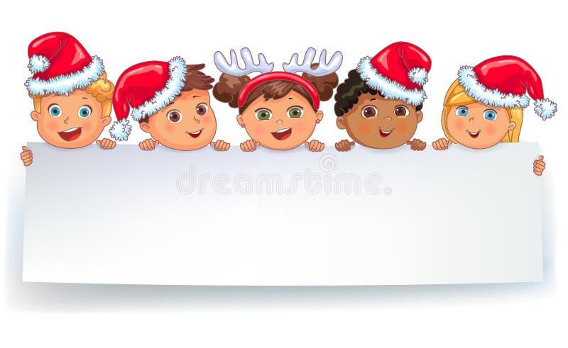 在盖帽拿着白色空白的横幅的圣诞老人的逗人喜爱的孩子 皇族释放例证