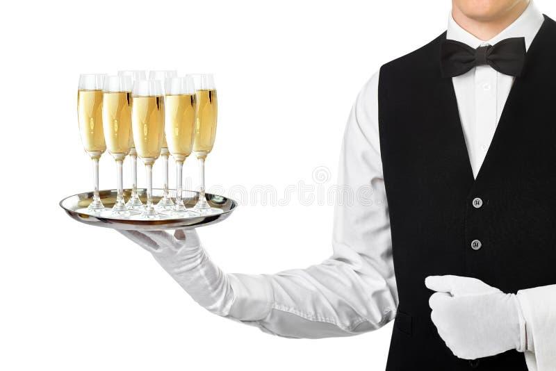 在盘子的典雅的侍者服务香槟 免版税库存照片
