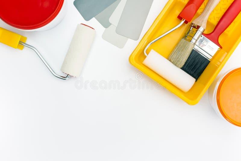 绘在盘子的工具有油漆罐头的 库存图片