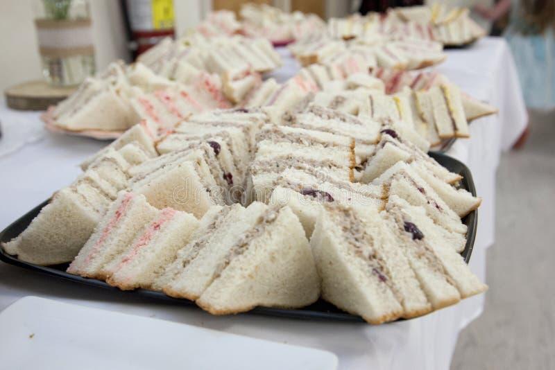 在盘子的手指三明治 库存照片