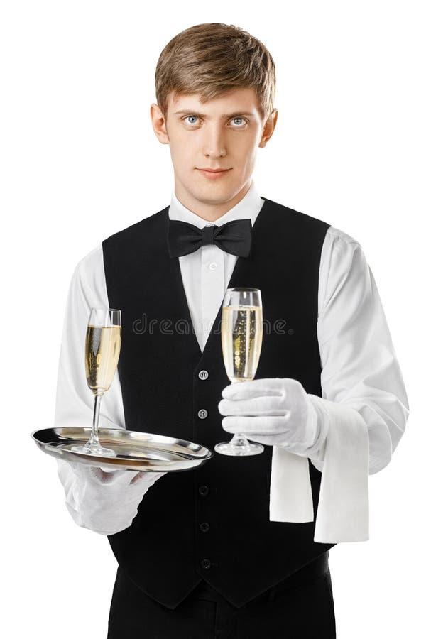 在盘子的年轻侍者服务香槟 库存图片