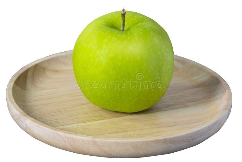 在盘木孤立的新鲜,绿色苹果在白色背景 库存照片