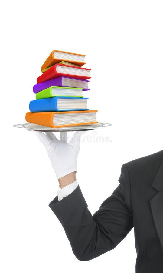在盘的侍者服务的书 免版税库存照片