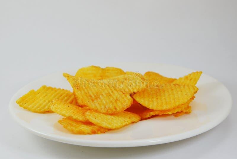 在盘的土豆片 图库摄影