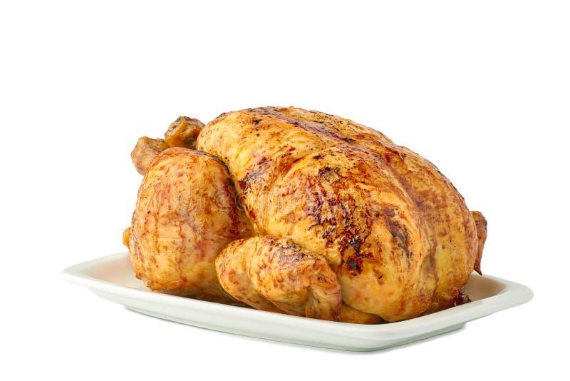 在盘的烤酥脆鸡在白色背景 图库摄影