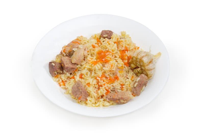 在盘的煮熟的肉饭在白色背景 免版税图库摄影