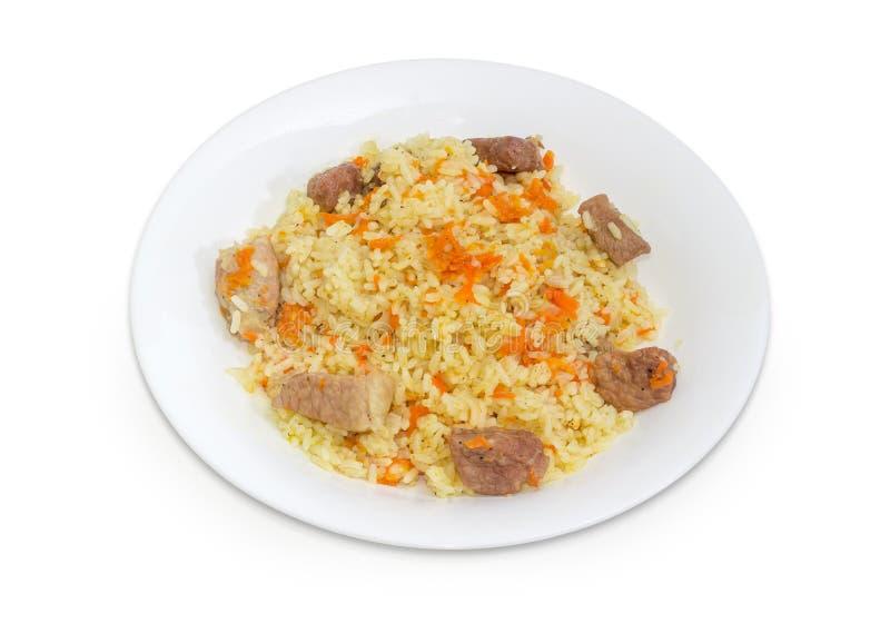 在盘的煮熟的肉饭在白色背景 库存图片