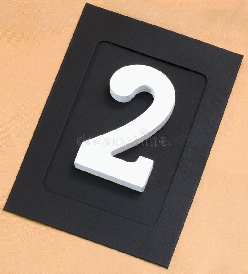 在相框的木白色第二在金背景 免版税库存照片