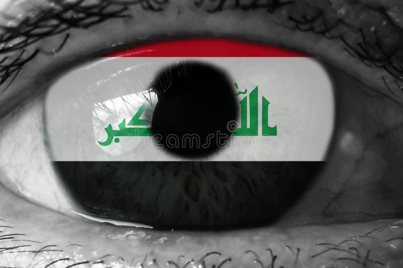 在眼睛的伊拉克旗子 免版税库存图片