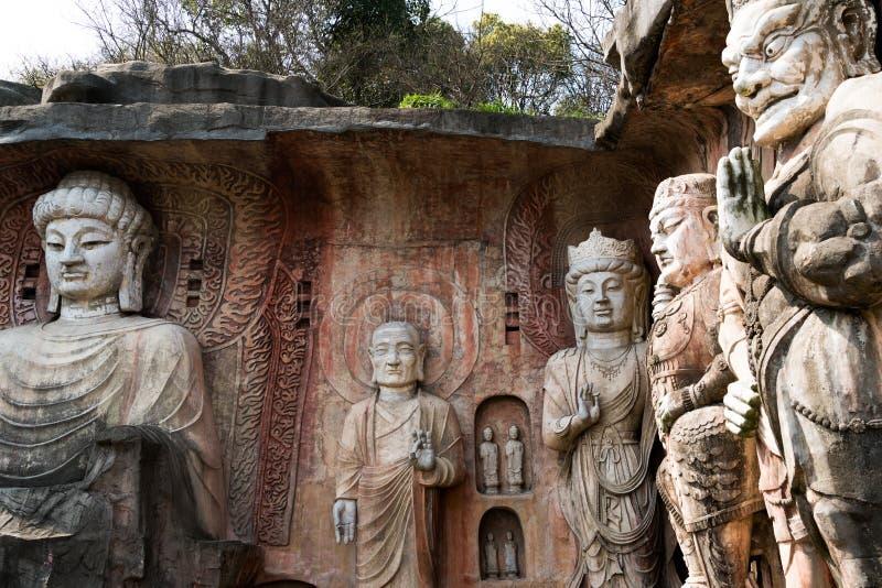 在石墙上的大石菩萨在无锡鼋头渚- Taihu风景庭院,中国 图库摄影