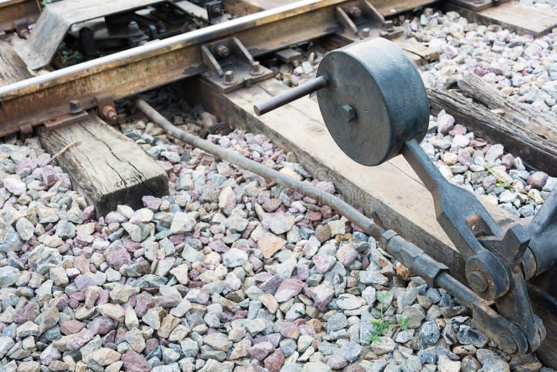 在石渣的铁路手控开关 免版税库存照片