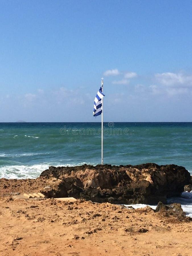 在石头的希腊旗子 库存图片