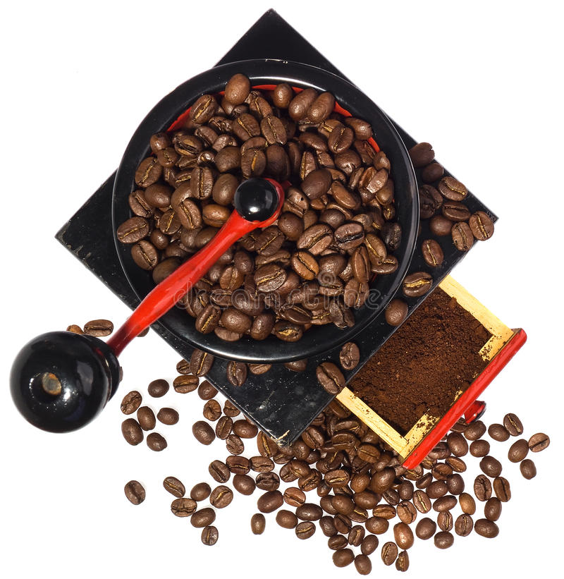 在研的咖啡期间的老磨咖啡器 库存照片