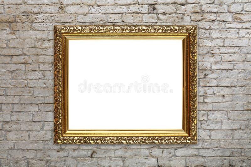 在砖墙上的古色古香的金黄图片照片框架 库存图片