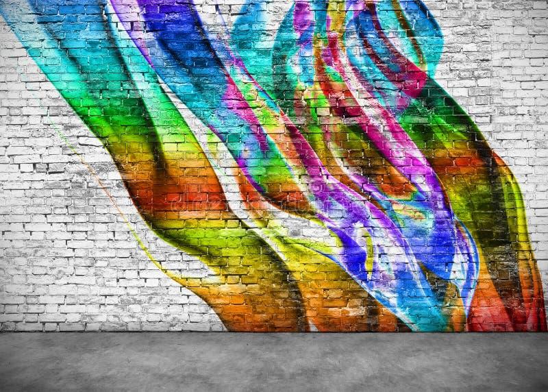 在砖墙上的抽象五颜六色的街道画 库存照片