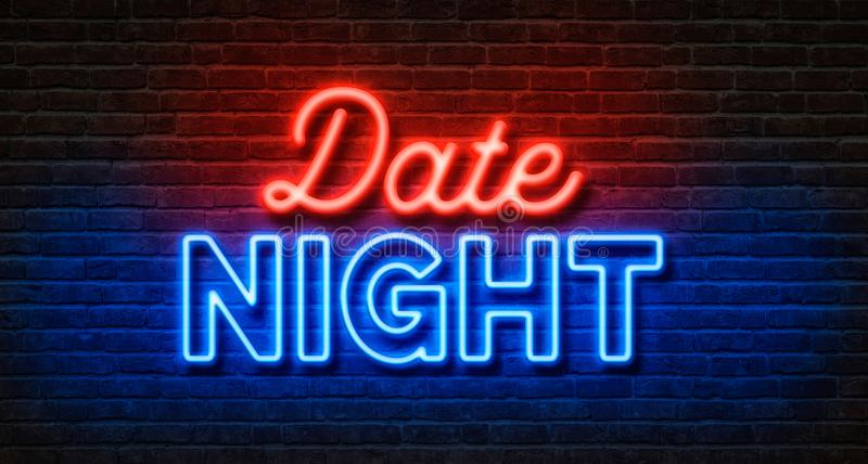 在砖墙上的霓虹灯广告-约会夜 免版税库存图片