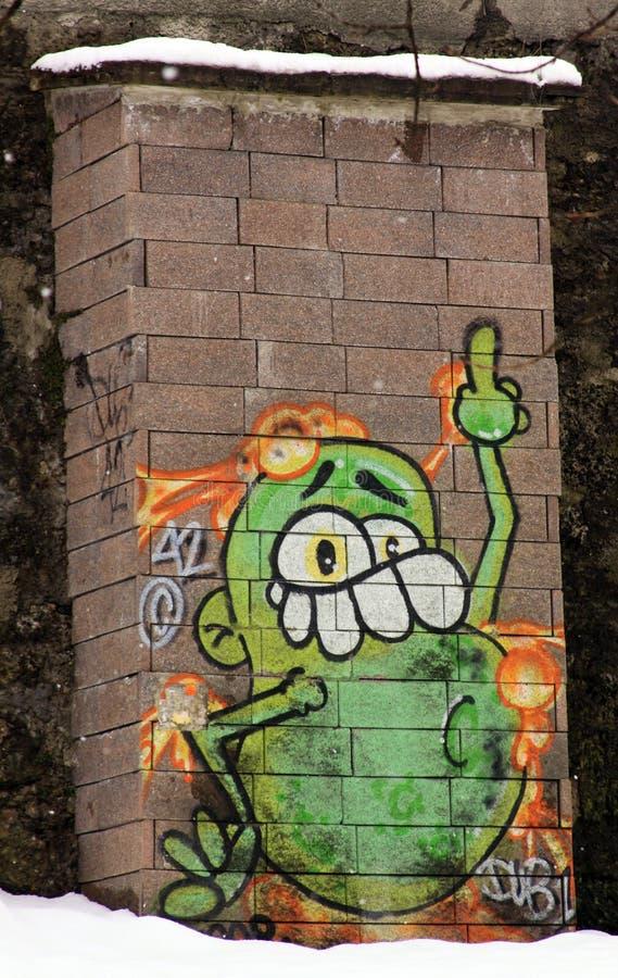 在砖墙上的滑稽的街道画在萨尔茨堡 免版税库存图片