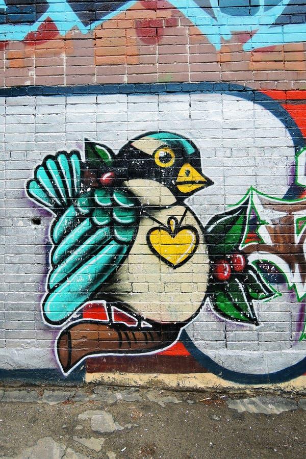 在砖墙上绘的鸟 向量例证